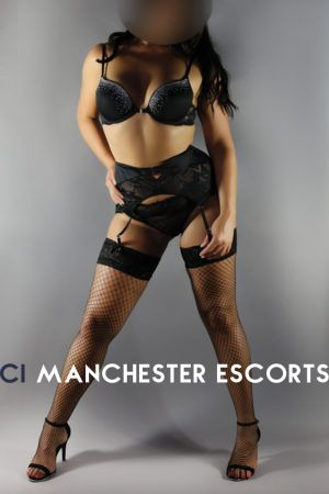 Emily stood up in black lingerie with black fishnet stockings and suspenders with high heels