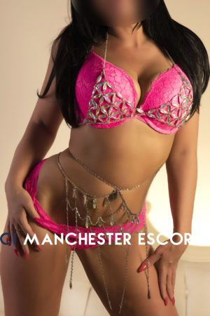 Libby wearing a bright pink lingerie set and a diamonti chain round her waist