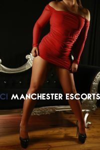Nina wearing tight red dress with Black Heels