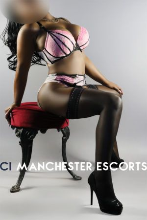 Crystal sat on stool in a sexy pose wear pink and black lingerie and black stockings