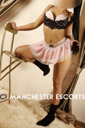 Manchester escort Leah wearing pink and black lingerie