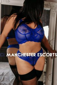 Carmen wearing blue lace lingerie and black stockings