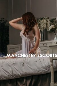beautiful sheer laced night wear on eleanor knelt on a vintage bed