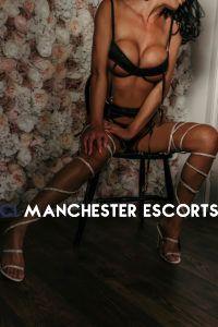 sienna in naughty tie up diamonte heels in black underwear against floral wall
